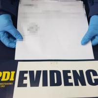 PDI detiene a 2 sujetos por el delito de falsificación ideológica de documento privado.
